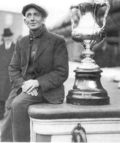 Captain Angus Walters of Lunenburg with the International Fishermen's Trophy on board Bluenose.